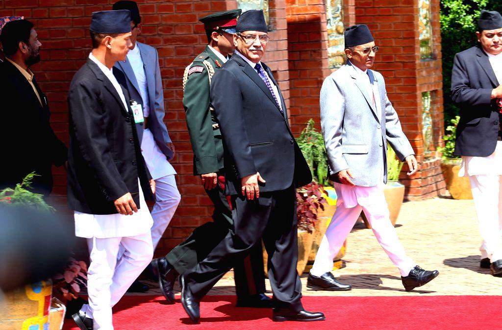 KATHMANDU, Sept. 15, 2016 - Nepalese Prime Minister Pushpa Kamal Dahal (front C) leaves for India at the Tribhuwan International Airport in Kathmandu, capital of Nepal, on Sept. 15, 2016. Nepalese ... - Pushpa Kamal Dahal