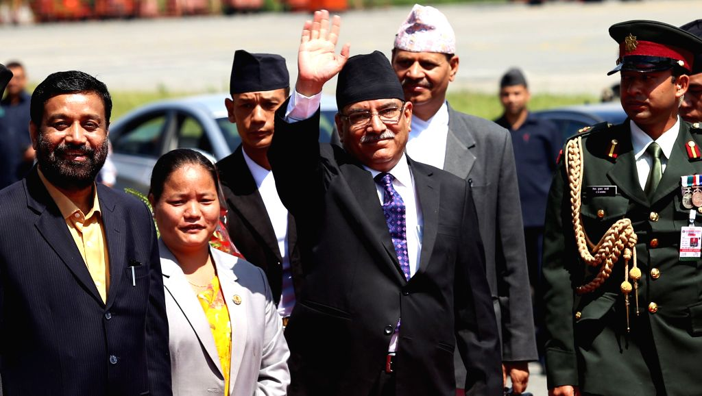 KATHMANDU, Sept. 15, 2016 - Nepalese Prime Minister Pushpa Kamal Dahal (front C) waves before leaving for India at the Tribhuwan International Airport in Kathmandu, capital of Nepal, on Sept. 15, ... - Pushpa Kamal Dahal