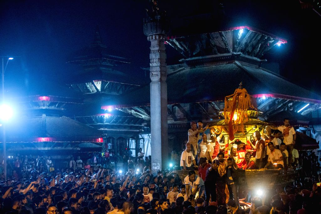 KATHMANDU, Sept. 15, 2019 - Devotees pull the chariot during the chariot procession of Indrajatra festival at the premises of Basantapur Durbar Square in Kathmandu, Nepal, on Sept. 14, 2019. The ...