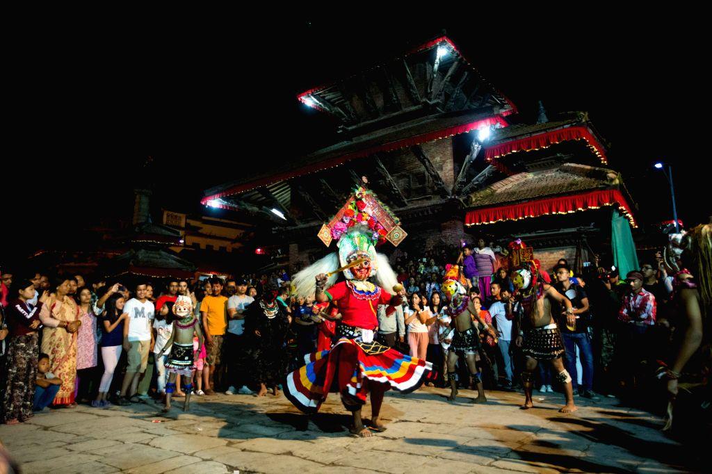 KATHMANDU, Sept. 15, 2019 - Masked dancers perform during the celebration of Indrajatra festival at the premises of Basantapur Durbar Square in Kathmandu, Nepal, on Sept. 14, 2019. The eight-day ...