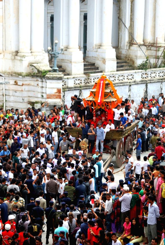 KATHMANDU, Sept. 17, 2016 - Nepalese people participate in a chariot procession during Indrajatra Festival at Hanumandhoka Durbar Square in Kathmandu, capital of Nepal, on Sept. 16, 2016. Nepalese ...