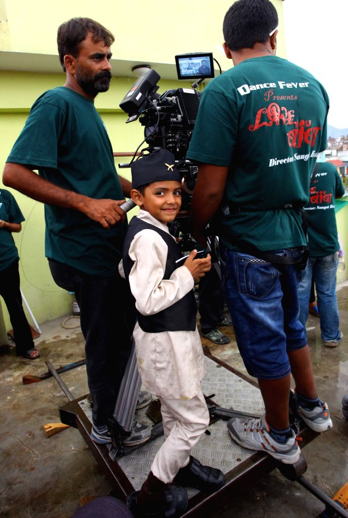 "Nepalese child Saugat Bista (C) aged 8 directs a Nepali film ""Love You Baba"", in attempt to break the record of Indian child director Kishan Shrikanth .."