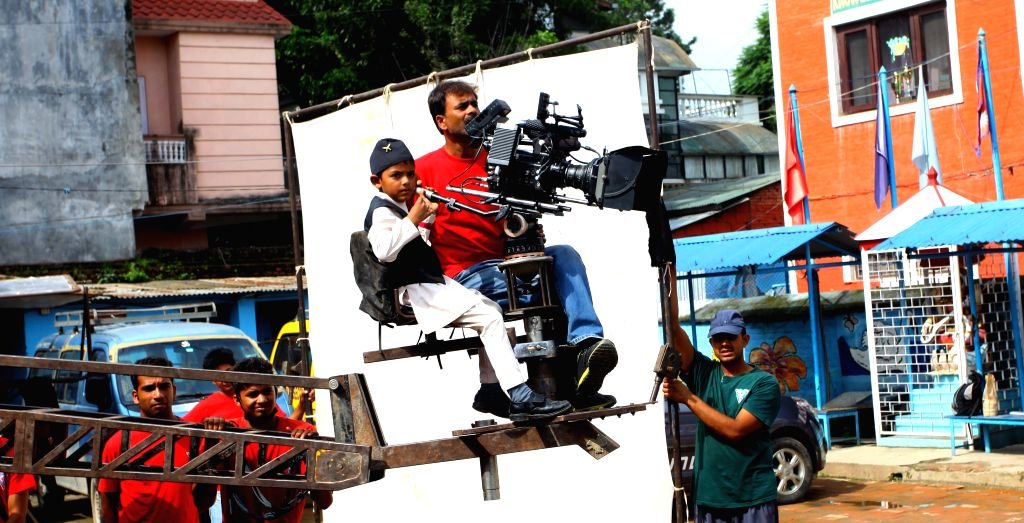 "Nepalese child Saugat Bista (L) aged 8 directs a Nepali film ""Love You Baba"", in attempt to break the record of Indian child director Kishan Shrikanth .."