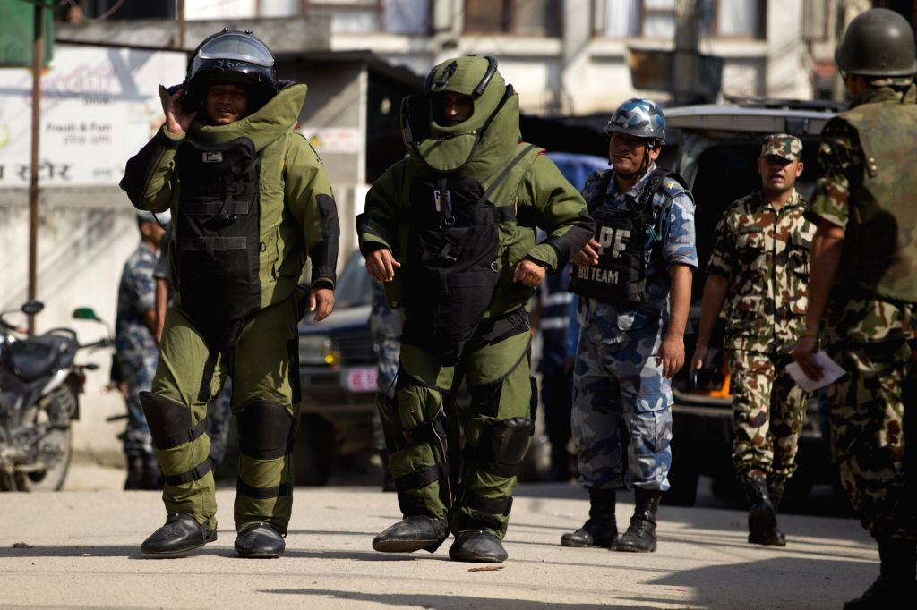 KATHMANDU, Sept. 20, 2016 - Members of a bomb disposal team get ready to inspect a suspicious pressure cooker after a bomb scare outside the Kanchanjunga School in Kathmandu, Nepal, Sept. 20, 2016. ...