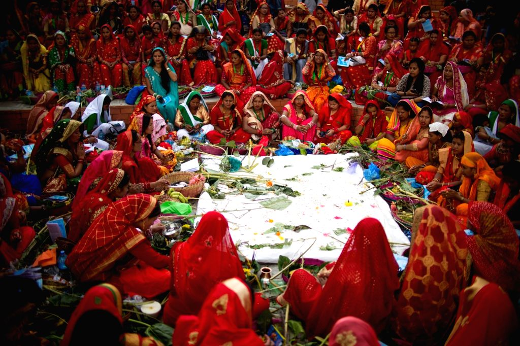 KATHMANDU, Sept. 22, 2019 - Women from the local Tharu community attend a mass prayer to celebrate the Jitiya festival in Kathmandu, Nepal, Sept. 22, 2019. The Jitiya festival is mostly celebrated by ...
