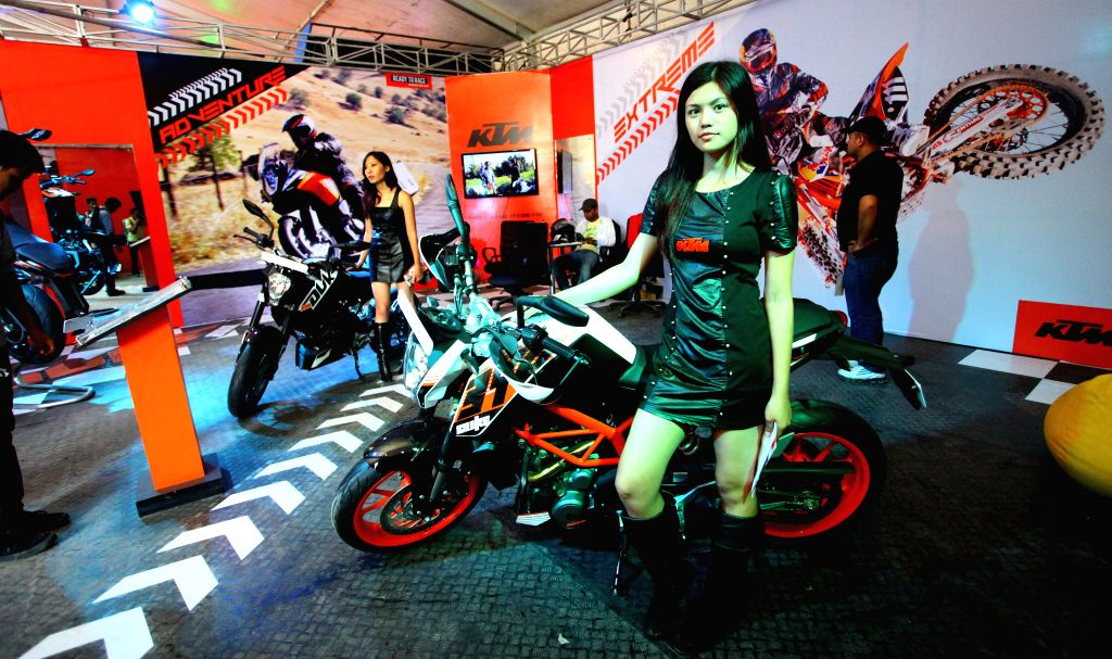 Models pose with motorcycles at Nepal Automobile Dealers' Association (NADA) Auto Show 2014 in Kathmandu, Nepal, Sept. 3, 2014.