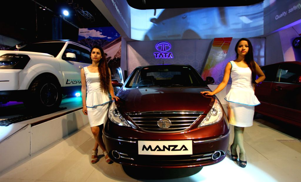 Models pose with a car at Nepal Automobile Dealers' Association (NADA) Auto Show 2014 in Kathmandu, Nepal, Sept. 3, 2014.