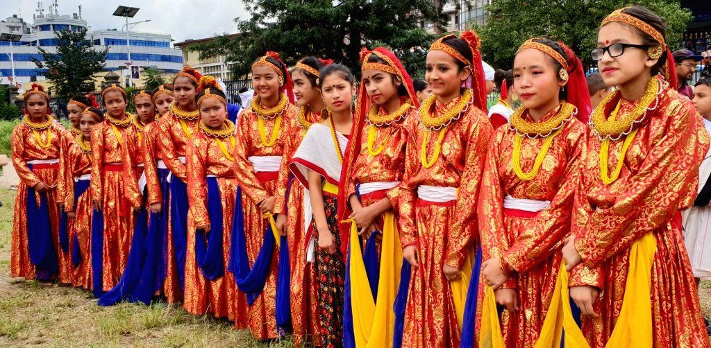 KATHMANDU, Sept. 3, 2018 - Girls from far western Nepal in traditional attire get ready to perform in celebration of Gaura festival at Tundikhel in Kathmandu, Nepal, Sept. 3, 2018. The Gaura festival ...