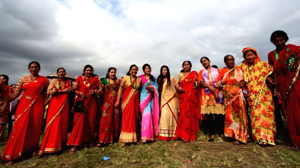 KATHMANDU, Sept. 3, 2018 - Women from far western Nepal perform a dance during the celebration of Gaura festival at Tundikhel in Kathmandu, Nepal, Sept. 3, 2018. The Gaura festival is mostly ...