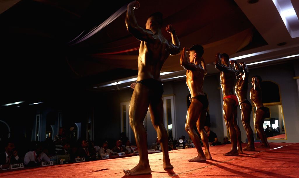 KATHMANDU, Sept. 7, 2019 - Contestants compete during the pre-judging round match of a national bodybuilding championship in Kathmandu, Nepal, Sept. 6, 2019.