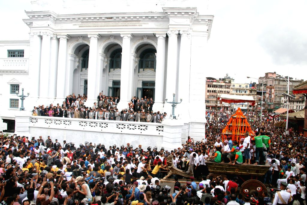 Devotees observes the Indrajatra festival at Hanumandhoka Durbar Square in Kathmandu, Nepal, Sept. 8, 2014. Nepalese celebrate the Indrajatra festival to honor ...