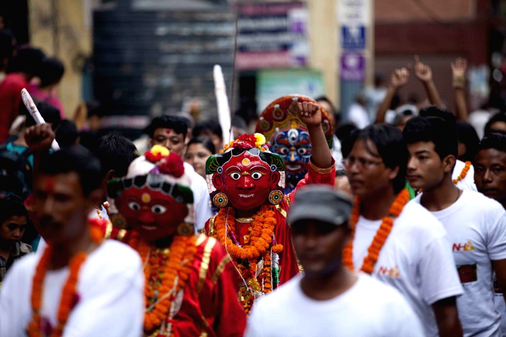 Nepalese devotees in traditional masks perform during Indrajatra festival at Basantapur Durbar Square in Kathmandu, Nepal, Sept. 8, 2014. Nepalese celebrate the ..