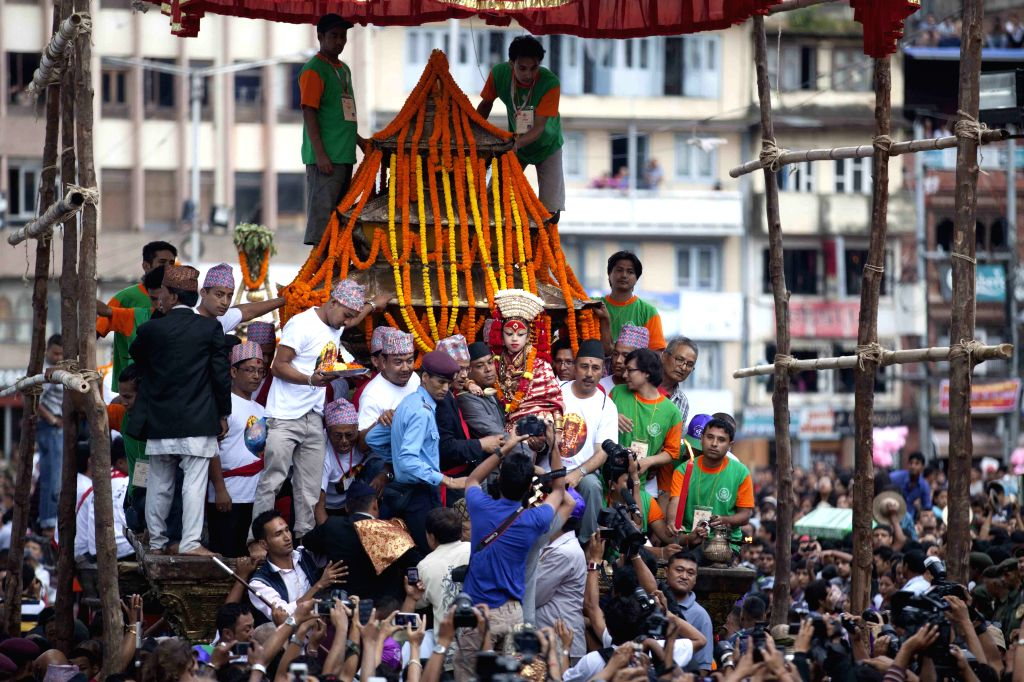 Nepalese Living Goddess is seen at the chariot procession during Indrajatra festival in Kathmandu, Nepal, Sept. 8, 2014. Nepalese celebrate the Indrajatra ...