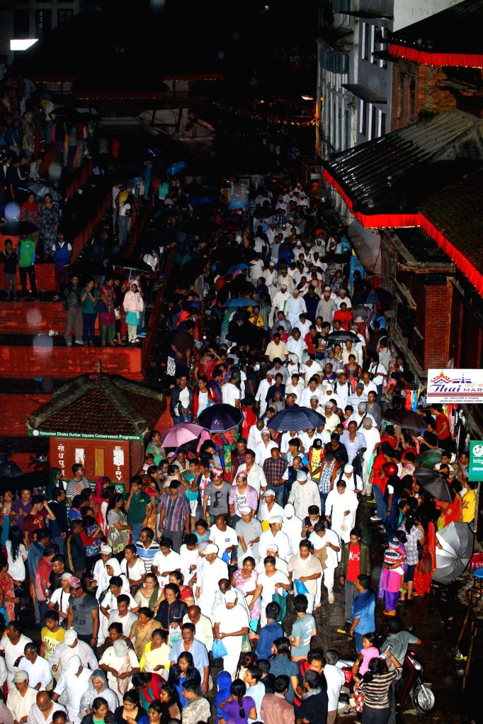 """Devotees participate in """"Dangi"""", an event to remember the deceased, during the Indrajatra Festival in Kathmandu, Nepal, on Sept. 8, 2014. Chariots of ..."""