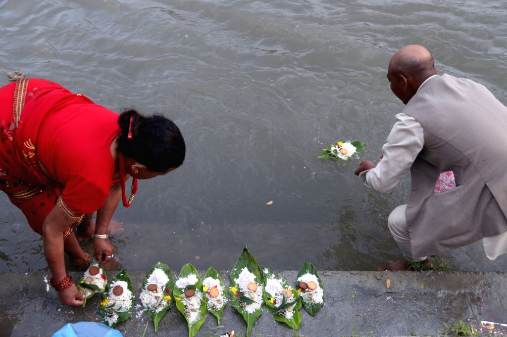 KATHMANDU, Sept. 9, 2018 - A Hindu devotee offers prayers while performing religious rituals to celebrate Kuse Aunsi, or Father's Day, on the bank of Bagmati River at Gokarna Temple in Kathmandu, ...
