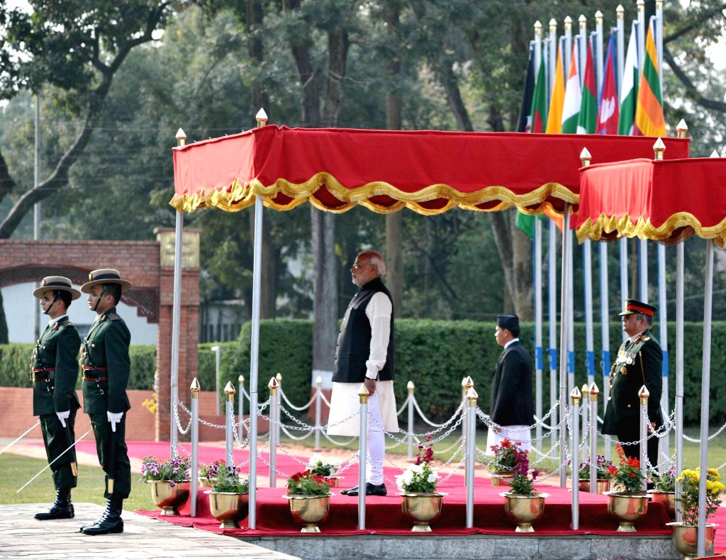 The Prime Minister Narendra Modi being accorded ceremonial reception at Kathmandu, in Nepal on Nov 25, 2014. Modi is visiting Nepal to participate in the 18th SAARC Summit - Narendra Modi
