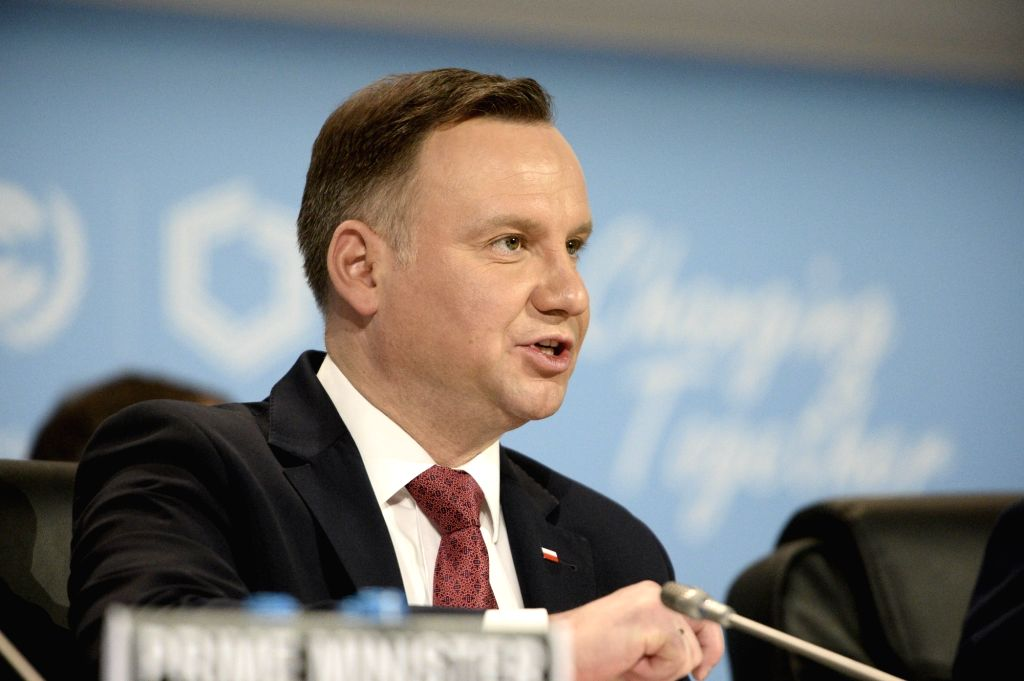 KATOWICE, Dec. 3, 2018 (Xinhua) -- Polish President Andrzej Duda addresses the UN Climate Change Conference in Katowice, Poland, Dec. 3, 2018. Delegates from nearly 200 countries began talks on Sunday on urgent actions to curb climate change three ye