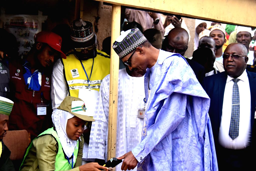 KATSINA, Feb. 23, 2019 - Nigerian President Muhammadu Buhari gets accredited before casting his vote at a polling station in the 2019 Presidential and National Assembly Elections in Daura in Katsina ...