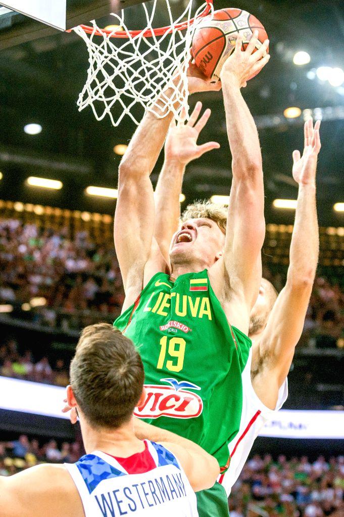 KAUNAS, Aug. 16, 2017 - Mindaugas Kuzminskas of Lithuania dunks during a friendly match against France before Eurobasket 2017 in Kaunas, Lithuania, Aug. 15, 2017. Lithuania won 96-71.