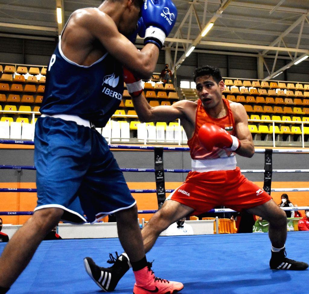 Kaushik, Husamuddin march into quarters at Boxam International Tournament
