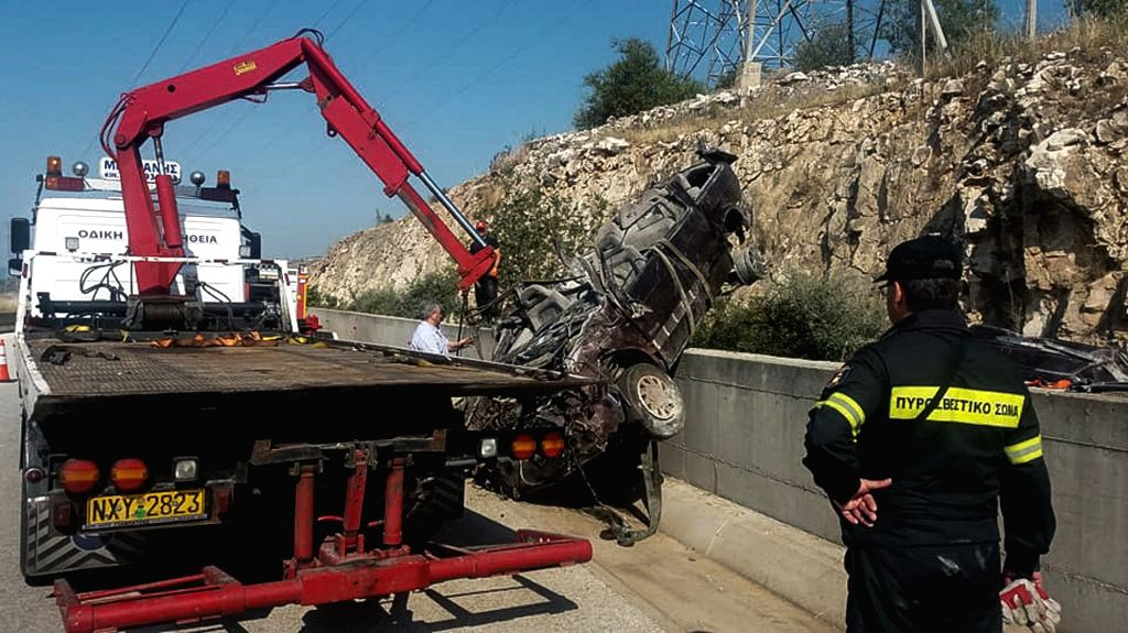 KAVALA (GREECE), June 8, 2018 A tow truck tries to lift up a car that crashed in Egnatia highway, near Kavala, north of Greece, June 8, 2018. A highway accident on Friday killed six ...