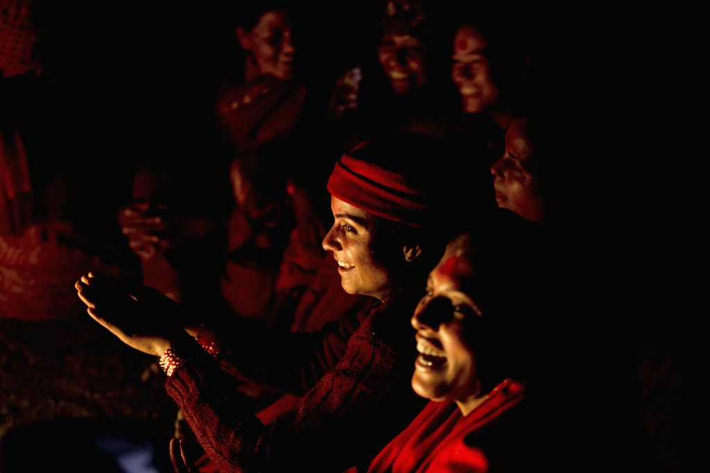 Nepalese Hindu devotees smile during the Madhav Narayan festival at Panauti in Kavre, Nepal, Jan. 24, 2015. Nepalese Hindu women observe a fast and pray to Goddess ...