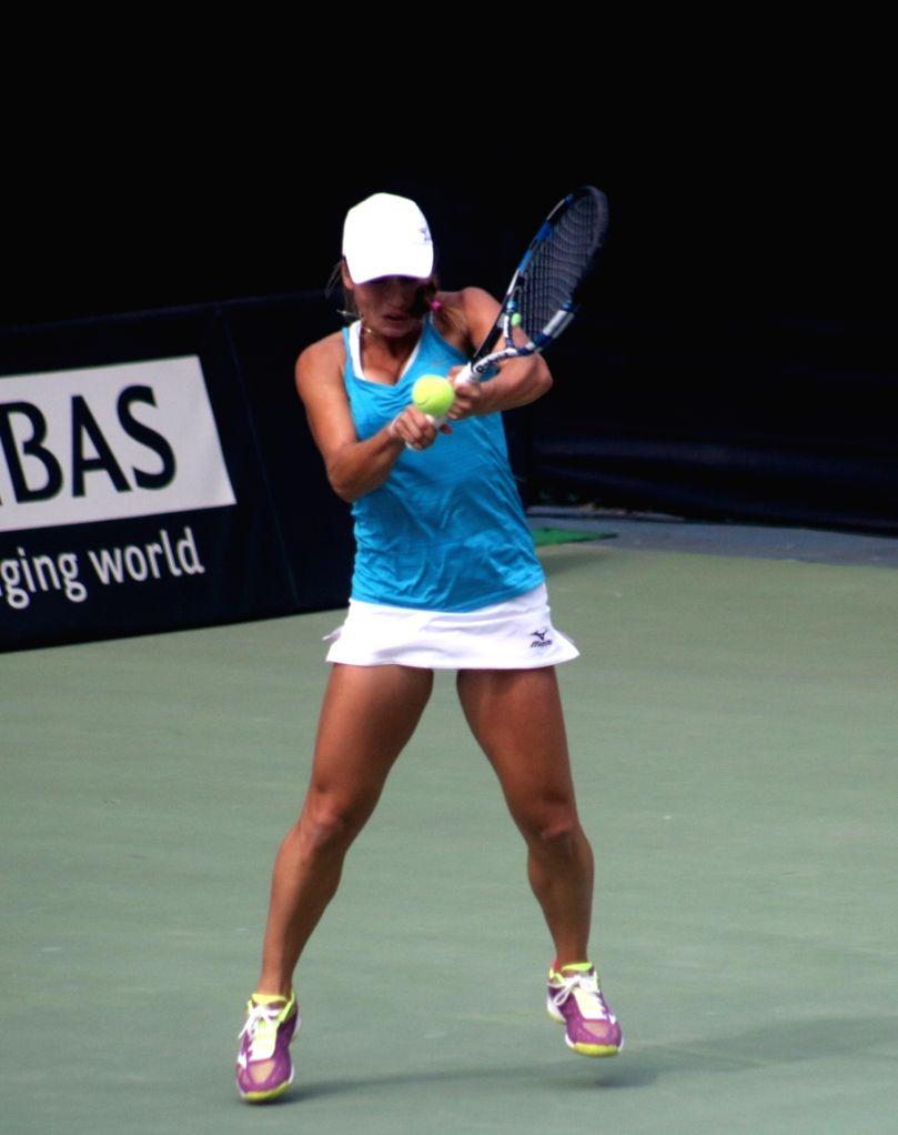 Kazakhstan's Yulia Putintseva in action against India's Ankita Raina during 2018 Fed Cup at R.K. Khanna Tennis Complex in New Delhi on Feb 8, 2018.