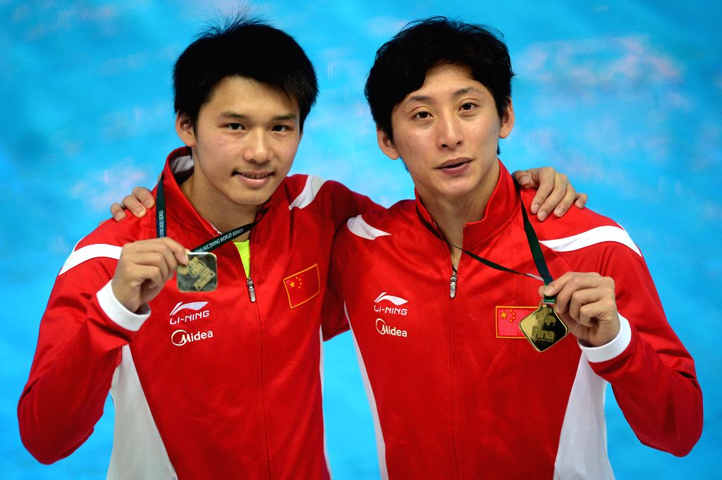 KAZAN, April 22, 2016 - Gold medalists Chen Aisen and Lin Yue of China (L-R) pose during awarding ceremony for men's 10m synchro platform final at FINA/NVC diving world series in Kazan, Russia, April ...