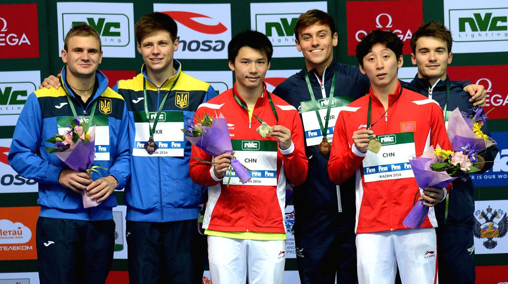 KAZAN, April 22, 2016 - Silver medalists Oleksandr Gorshkovozov and Maksym Dolgov of Ukraine, gold medalist Chen Aisen of China, bronze medalist Thomas Daley of Great Britain, gold medalist Lin Yue ...