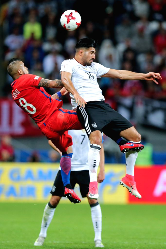 KAZAN, June 23, 2017 - Emre Can (Top)of Germany vies with Arturo Vidal (L)of Chile during group B match between Germany and Chile at the 2017 FIFA Confederations Cup in Kazan, Russia, on June 22, ...