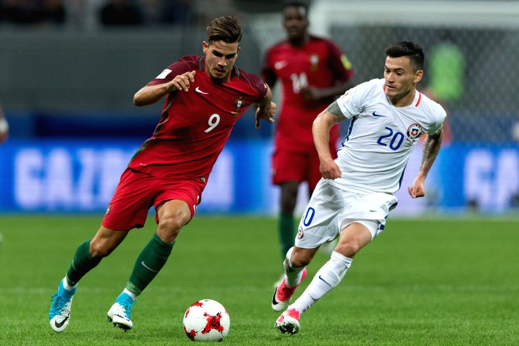 KAZAN, June 29, 2017 - Andre Silva (L) of Portugal vies with Charles Aranguiz of Chile during the FIFA Confederations Cup 2017 semifinal match in Kazan, Russia, June 28, 2017.