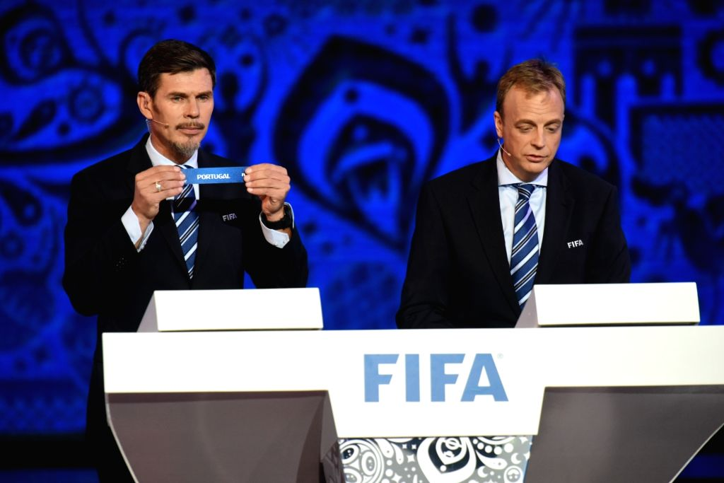 KAZAN, Nov. 27, 2016 - Special adviser on the football matters Zvonimir Boban (L) and director of competitions of FIFA Colin Smith show Portugal during the official draw ceremony for Confederations ...