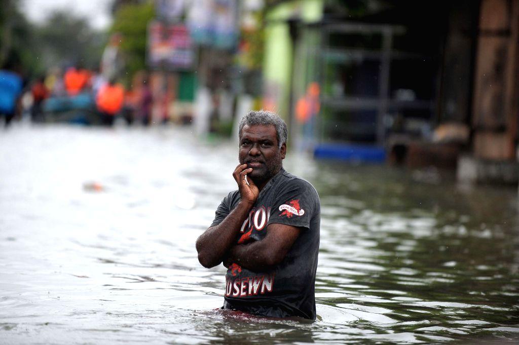 KELANIYA, May 21, 2016 - An old man makes his way through floodwaters in Kelaniya District, Sri Lanka, May 20, 2016. The death toll from Sri Lanka's flash floods and landslides rose to 64 on Friday ...