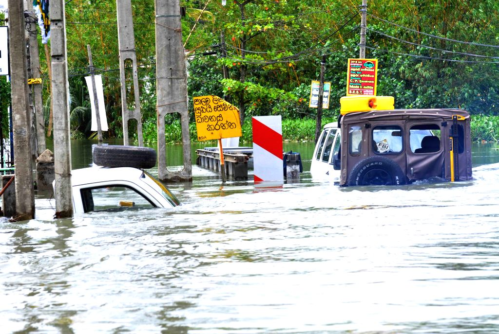 KELANIYA, May 21, 2016 - Photo taken on May 20, 2016 shows vehicles drown by floods in Kelaniya District, Sri Lanka. The death toll from Sri Lanka's flash floods and landslides rose to 64 on Friday ...