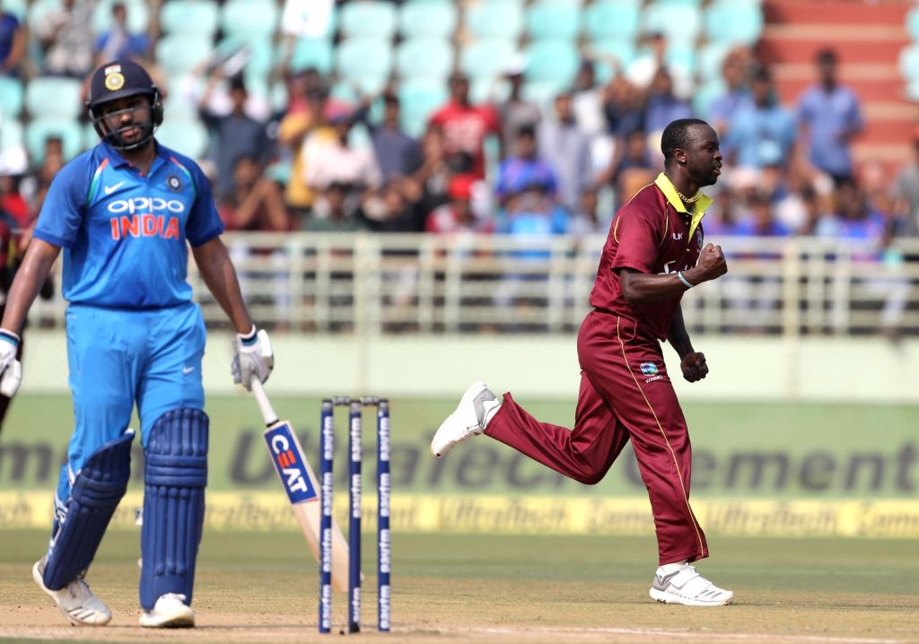 Kemar Roach of West Indies celebrates Rohit Sharma's wicket during the second ODI match between India and West Indies at Dr. Y.S. Rajasekhara Reddy ACA-VDCA Cricket Stadium in ... - Rohit Sharma