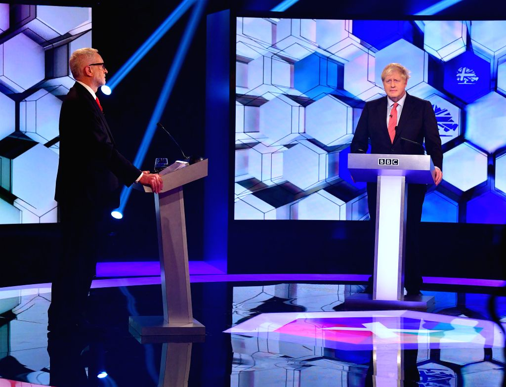 KENT, Dec. 7, 2019 - British Prime Minister and Conservative Party leader Boris Johnson (R) and Labor Party leader Jeremy Corbyn take part in a debate organized by BBC in Kent, Britain, Dec. 6, 2019. ...