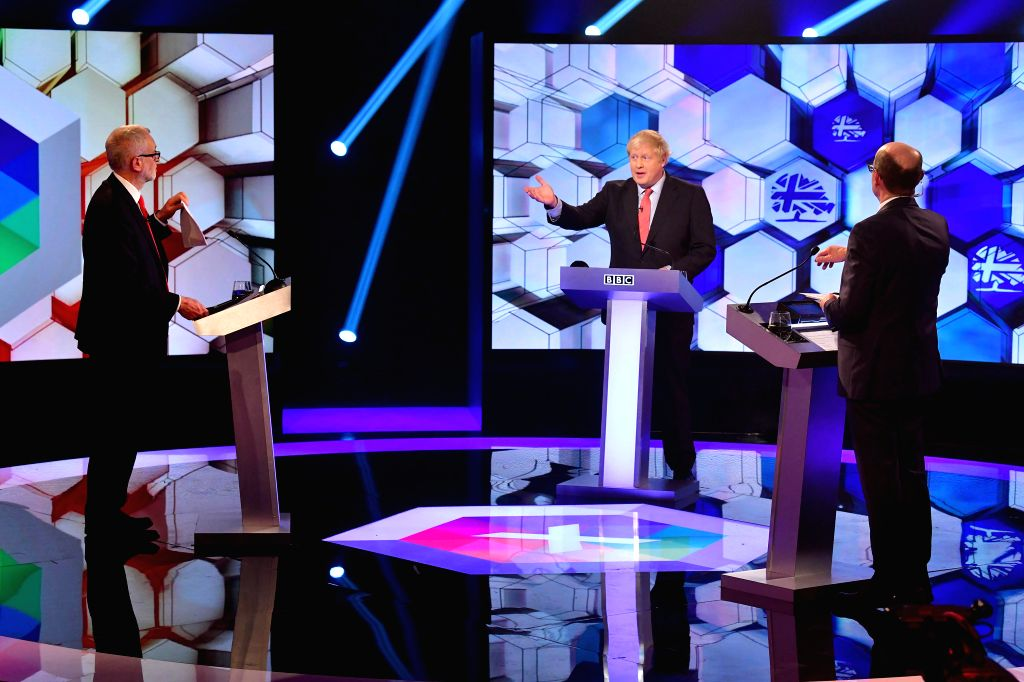 KENT, Dec. 7, 2019 - British Prime Minister and Conservative Party leader Boris Johnson (C) and Labor Party leader Jeremy Corbyn (L) take part in a debate organized by BBC in Kent, Britain, Dec. 6, ...