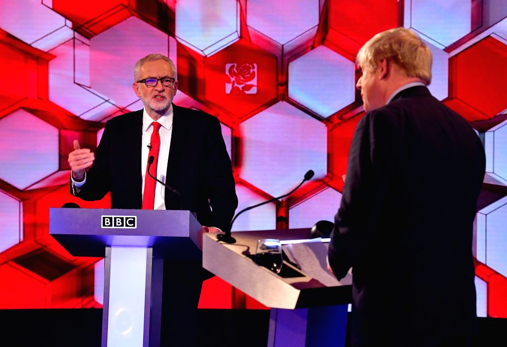 KENT, Dec. 7, 2019 (Xinhua) -- British Prime Minister and Conservative Party leader Boris Johnson (R) and Labor Party leader Jeremy Corbyn take part in a debate organized by BBC in Kent, Britain, Dec. 6, 2019. The debate was the last scheduled meetin