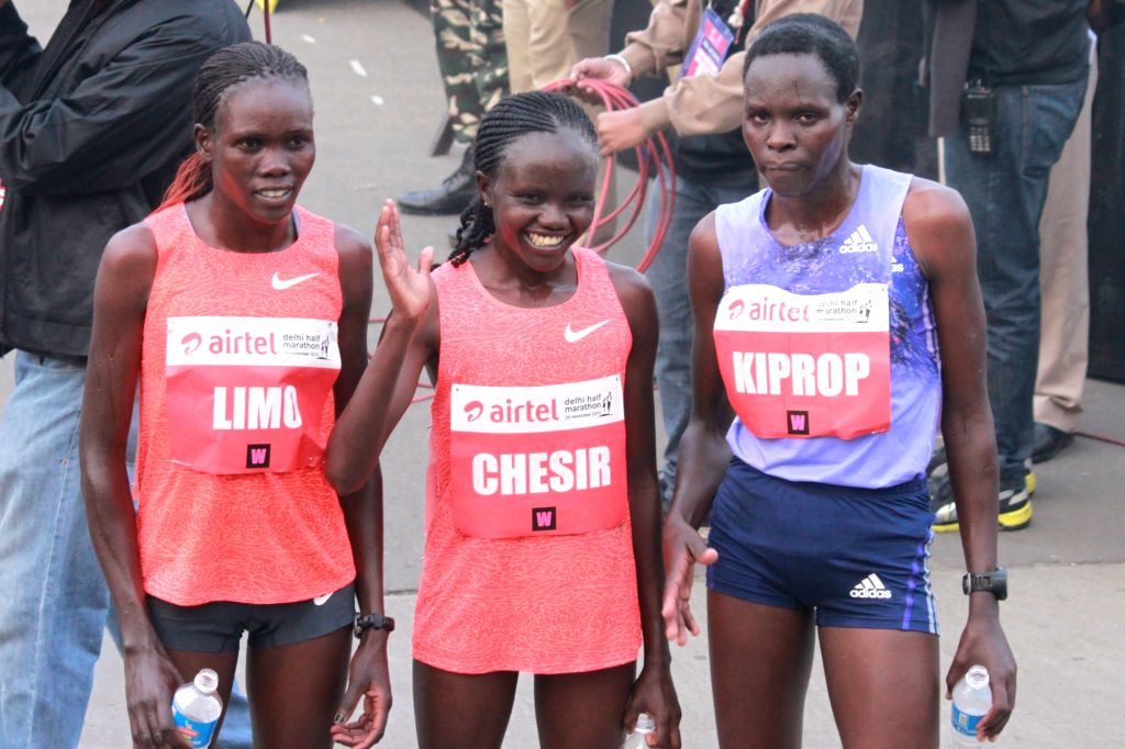 Kenyan Cynthia Limo, Helah Kiprop and Gladys Chesir after the finish of Elite Women event at the Airtel Delhi Half Marathon, on Nov 29, 2015.