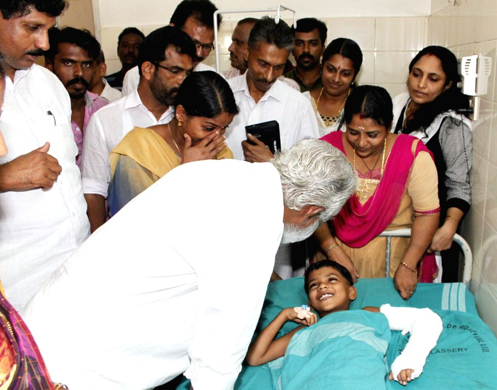 Kerala BJP chief Kummanam Rajasekharan meets ET Karthik seven-year-old son of a BJP worker who was admitted to a hospital after allegedly being stabbed by CPI-M leader in Kannur on May 31, ...