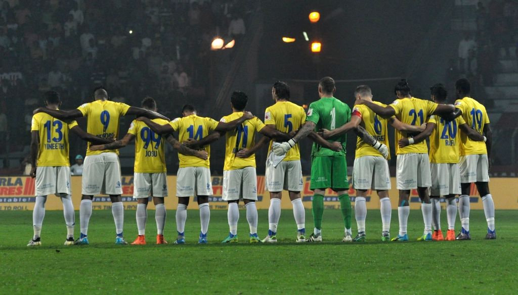 Kerala Blasters FC players observe one-minute silence for the Brazil's Chapecoense football team players who died in a plane crash during an ISL match between Atletico de Kolkata and Kerala ...