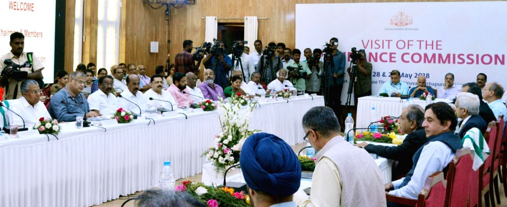 Kerala Chief Minister Pinarayi Vijayan, 15th Finance Commission Chairman N.K. Singh along with the members, during formal presentations made by the state government at a meeting, ... - Pinarayi Vijayan and K. Singh