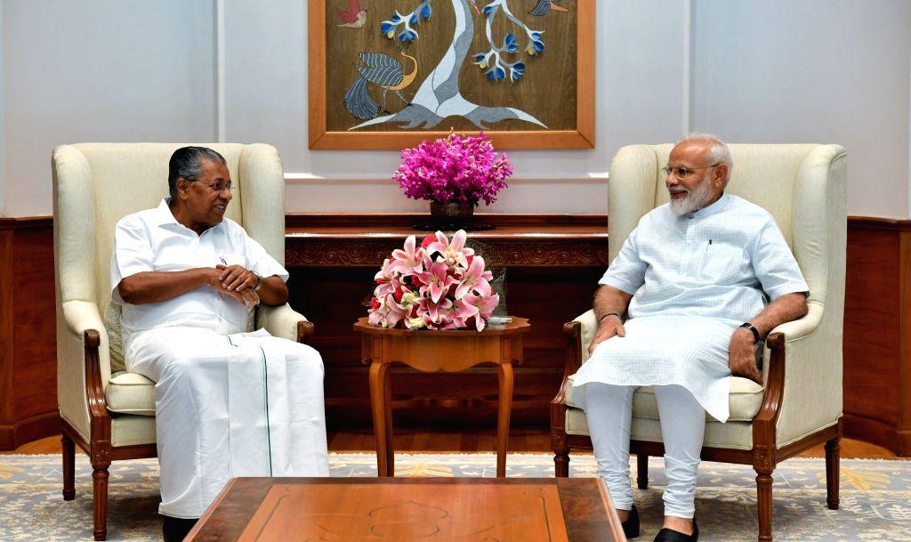 Kerala Chief Minister Pinarayi Vijayan meets Prime Minister Narendra Modi, in New Delhi on June 15, 2019. - Pinarayi Vijayan and Narendra Modi