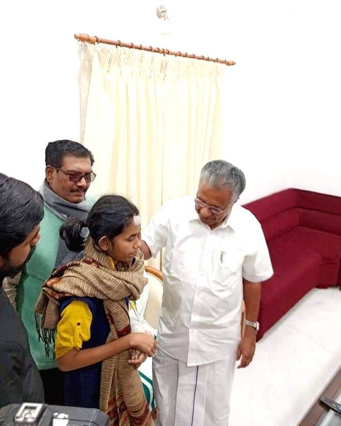 Kerala Chief Minister Pinarayi Vijayan meets Jawaharlal Nehru University Students Union (JNUSU) President Aishe Ghosh at Kerala House in New Delhi on Jan 11, 2020. - Pinarayi Vijayan and Aishe Ghosh