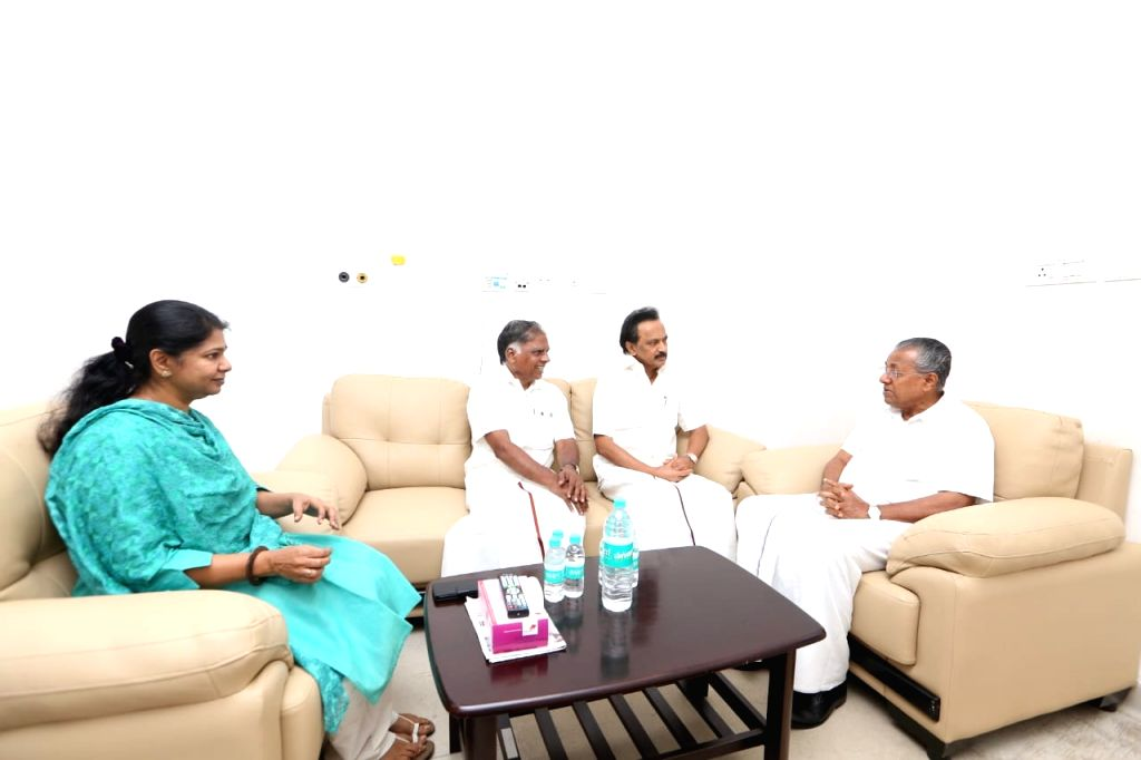 Kerala Chief Minister Pinarayi Vijayan with DMK leaders M.K. Stalin and Kanimozhi during his visit to the Kauvery Hospital where DMK President M. Karunanidhi is admitted, in Chennai on Aug ... - Pinarayi Vijayan