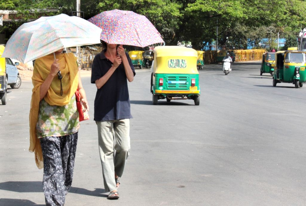 Kerala villagers will ensure the one metre social distancing norm amid the coronavirus outbreak by using an umbrella each. (File Photo: IANS)