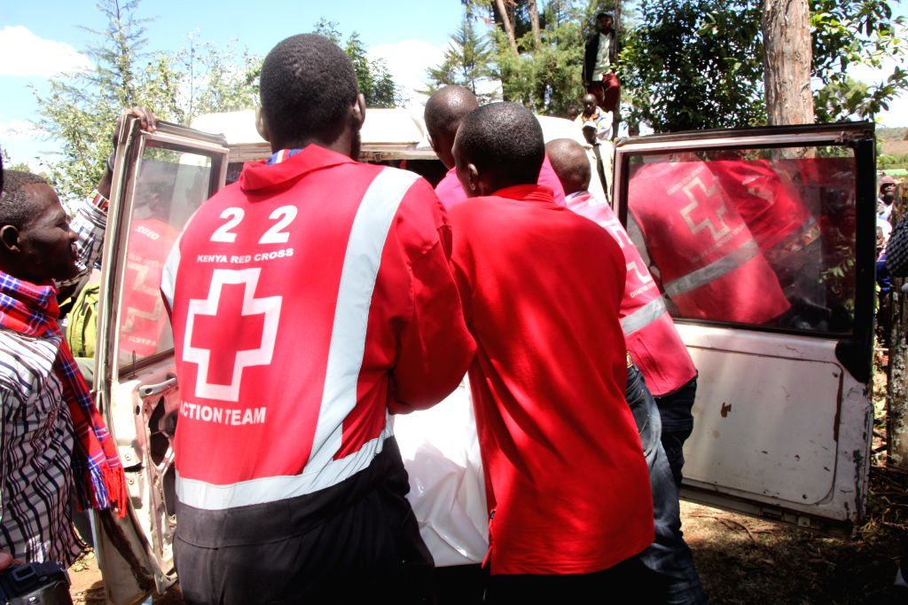 KERICHO, Feb. 13, 2019 - Kenyan Red Cross staffs carry the remains of the victims in a plane crash in Kericho County in northwest Kenya on Feb. 13, 2019.  Five foreigners were killed when a light ...