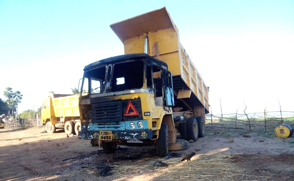 A truck that was allegedly destroyed by Maoists along with other vehicles being used for road construction, in Khammam district of Telangana on Jan 6, 2015.