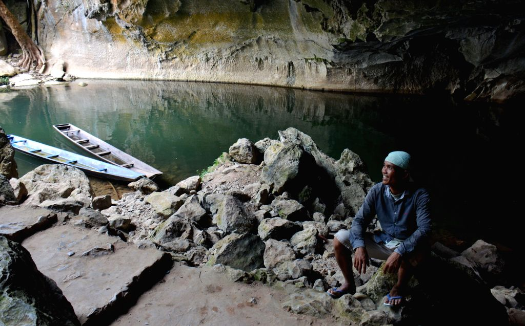 KHAMMOUANE, April 10, 2017 - A boatman wait for tourists outside the Kong Lor Cave in Khammouane Province, Laos, April 9, 2017. The Kong Lor Cave is a karst limestone cave in the Phu Hin Bun National ...