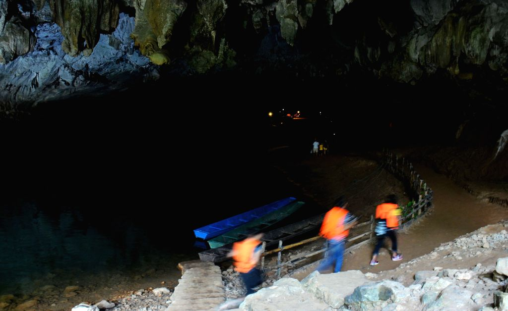 KHAMMOUANE, April 10, 2017 - Tourists visit the Kong Lor Cave in Khammouane Province, Laos, April 9, 2017. The Kong Lor Cave is a karst limestone cave in the Phu Hin Bun National Park in Khammouane. ...